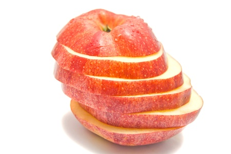slices of red apple on white photo