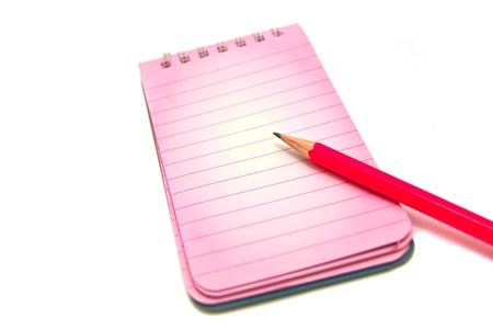 notepad and pencil close-up on white background photo