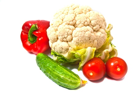 cauliflower, peppers, cucumbers and tomatoes on white Stock Photo - 13799285