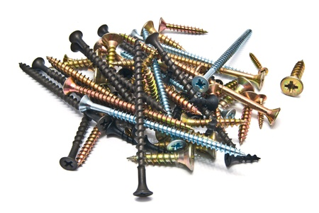 stack of different screws on white background