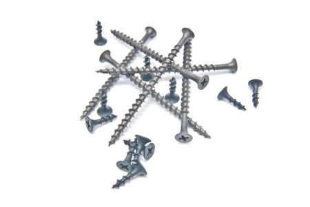 set of black screws close-up on white background photo