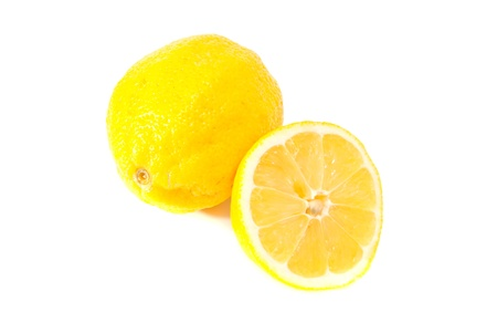 fresh lemon with half on white background