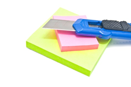 office knife and sticky notes on white background Stock Photo - 17094774
