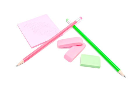 erasers, pencils and sticky note on white background Stock Photo - 17094683