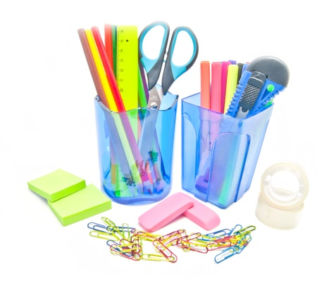 two containers with office supplies close-up on white background Stock Photo - 17094810