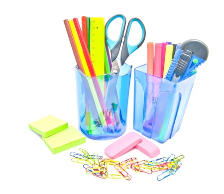 two containers with office supplies on white background photo