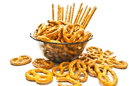 salted pretzels and breadsticks on a plate Stock Photo