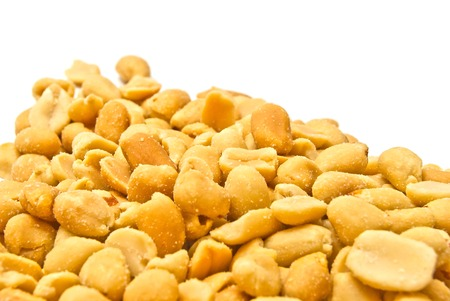many tasty roasted peanuts on white background closeup