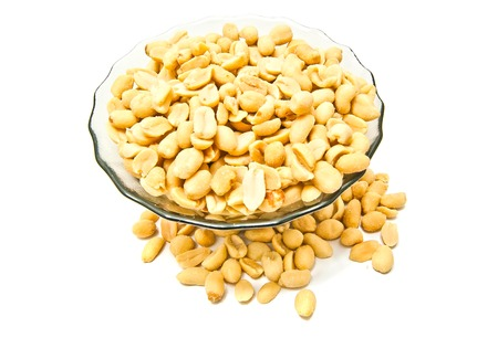 glass plate with roasted peanuts closeup on white Stock Photo