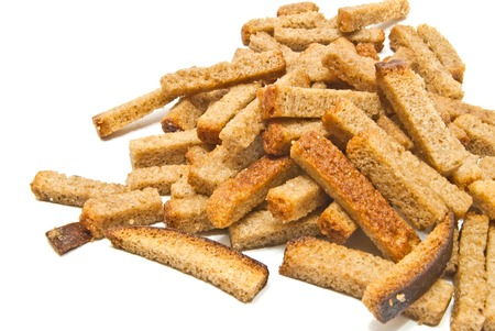 heap of tasty crackers on white closeup Stock Photo