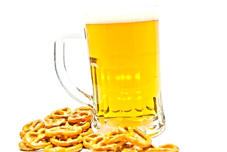 mug of beer and salted crackers on white closeup