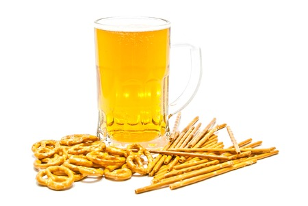 pretzels, breadsticks and light beer on white closeup Stock Photo