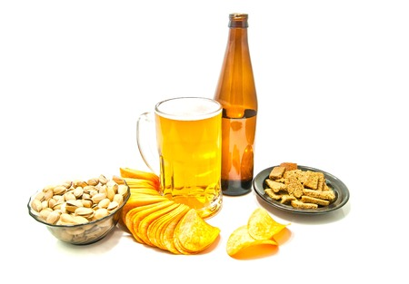 beer, chips, crackers and pistachios on white Stock Photo