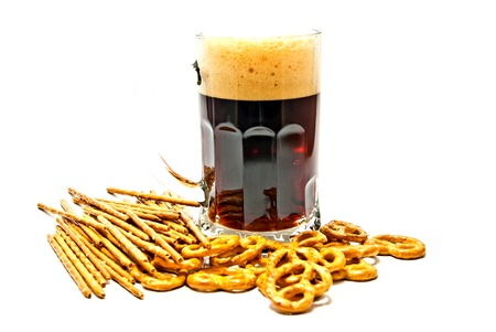 dark beer and pretzels on white background Stock Photo