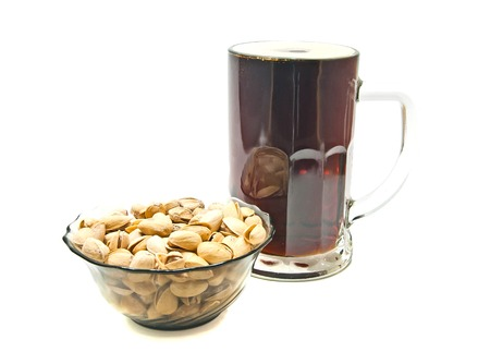 dark beer and pistachios on white background Stock Photo