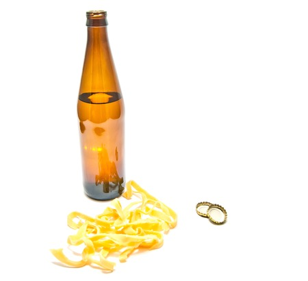bottle of beer and squid rings on white closeup