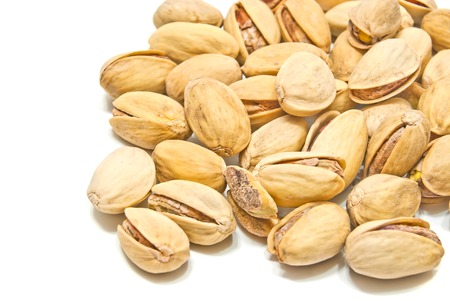 pistachios: yummy roasted pistachios on white background closeup
