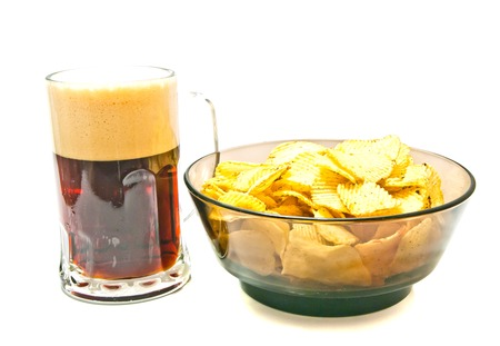 dark beer and chips on white closeup Stock Photo