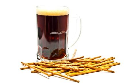 breadsticks: dark beer and breadsticks on white closeup