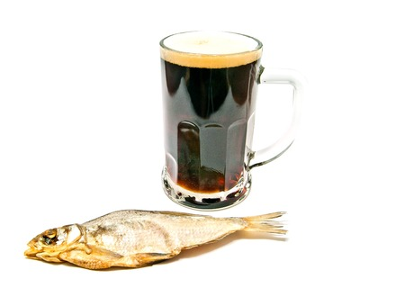 kipper: glass of beer and stockfish on white closeup