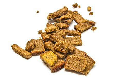 many tasty rye crackers closeup on white background c