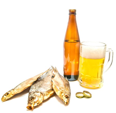 three stockfish and beer closeup on white Stock Photo