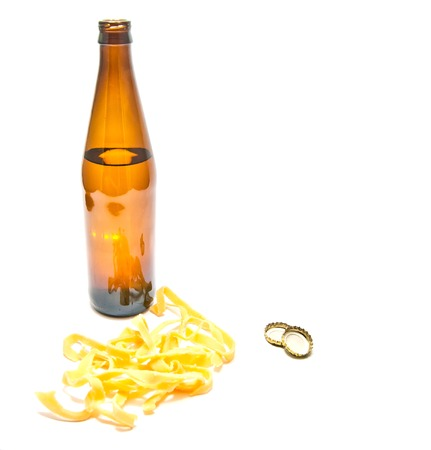 bottle of beer and squid rings closeup on white