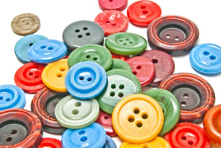 clothing buttons: many colorful clothing buttons on white closeup
