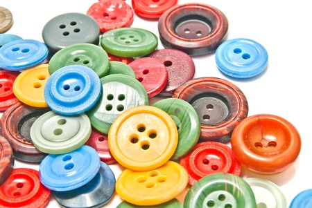 clothing buttons: many colorful clothing buttons on white background Stock Photo