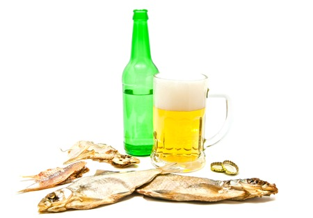 salty fishes and glass of beer closeup on white