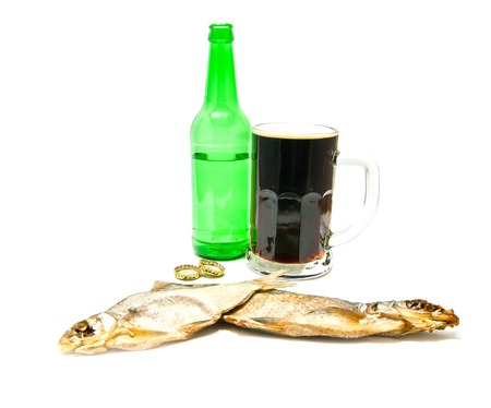 two salted fishes and beer closeup on white