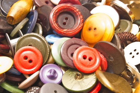 clothing buttons: heap of various colorful clothing buttons closeup