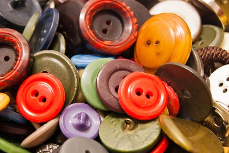 clothing buttons: texture of various colored clothing buttons closeup