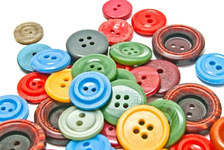 many colorful clothing buttons on white background closeup