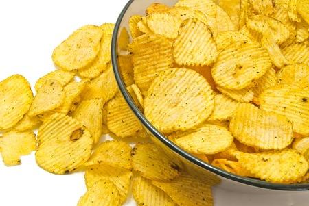 some corrugated potato chips on white closeup