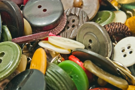 clothing buttons: heap of various colored clothing buttons closeup