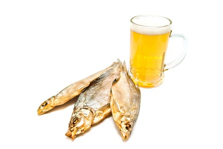 salted fish and beer closeup on white background photo
