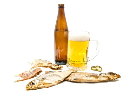 salty fishes and glass of light beer closeup on white