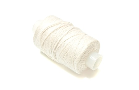 spool: spool of white thread on white background Stock Photo