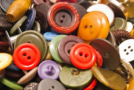 clothing buttons: texture of various colorful clothing buttons closeup