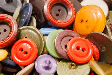 clothing buttons: texture of many different colored clothing buttons
