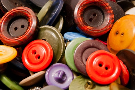 clothing buttons: heap of many colorful clothing buttons closeup
