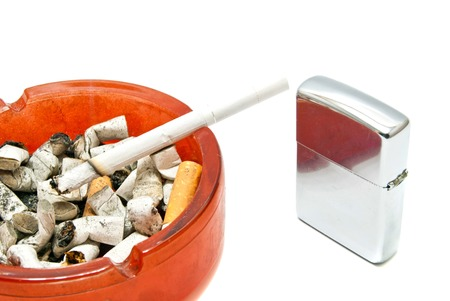 silver lighter and cigarette on white background