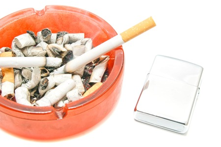 two cigarettes and lighter on white background closeup Stock Photo