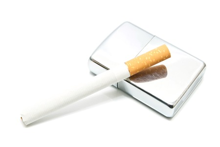 silver lighter and cigarette on white background closeup photo