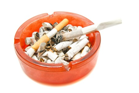 ashtray: cigarette in ashtray with butts on white