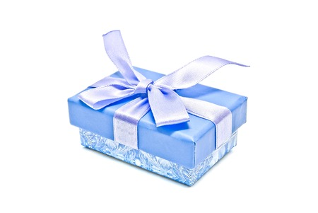 blue gift box: single blue gift box on white background closeup Stock Photo