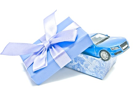 blue gift box: single blue gift box with car on white background Stock Photo