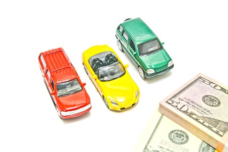 afford: three different cars and dollar notes on white