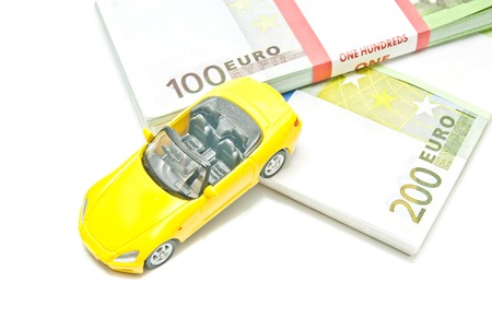 afford: euro notes and yellow car on white